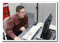 ?! (tigerplish) Tags: red people nerd mouse iso800 chair keyboard geek candid computers it monitor ups servers datacenter blueled kvm halon firebottle eyeglassess