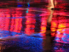 wet crossing (fotogail) Tags: street light reflection wet rain night neon crosswalk metreon fotogail gail:williams=2006 catchycolorsredandblue catchycolorskaleidoscope ilobsterit