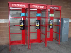 Telephone booths in front of Westgate Mall. (Steve Brandon) Tags: red ontario canada reflection geotagged phonebooth ottawa telephonebooth payphones phoneboxes canadapost  telephonebooths phonebooths telephoneboxes postescanada westgatemall