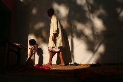 going to the temple (chris spira) Tags: light shadow india temple child father divine