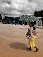 under the sun (janchan) Tags: poverty portrait people colors kids umbrella children retrato refugees documentary ghana donne liberia mujeres ritratto reportage povert pobreza refugeecamp buduburam whitetaraproductions sfidephotoamatori