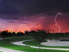 Hit Me Again (jimhankey) Tags: park sunset red arizona sky cloud storm tree green wet phoenix grass rain landscape grey cloudy scenic parks naturallight stormy valley vista thunderstorm topv777 redsky lightning