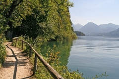 Path on the bank of the Wolfgangsee with St.Gilgen (rotraud_71 away again ~) Tags: trees sun mountains water fence austria shadows path bluesky wolfgangsee salzkammergut ilovethis 1on1landscapesphotooftheday photofans wegnachfrberg