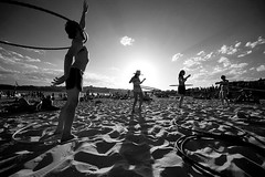 bondi hoops (nil by mouth) Tags: party bw sun beach bondi backlight hoop shadows action sunny 2006 hooping bunnys hulahoop bunnystar paulgosney acmp hoopstar