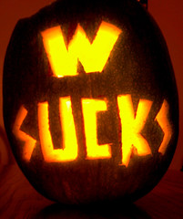 Dubya Sucks!! (rcvernors) Tags: light halloween yellow pumpkin george carved idiot bush war funny candle jackolantern georgewbush president failure w bad wanker conflict sucks backlit bully miserable dubya impeach miserablefailure rcvernors abigfave