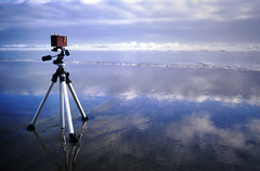 portrait of a camera: the watchful wooden pinhole and the big blue sea (manyfires) Tags: blue beach oregon waves manhattan tripod pinhole pacificocean pentaxk1000 pacificnorthwest zeroimage fujivelvia zero69