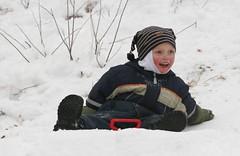 First snow (MiikaS) Tags: winter boy snow geotagged child play sled sledge geolat60310287 geolon25116634