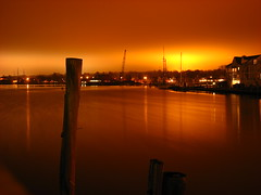 Mystic Seaport by Night (greendrz) Tags: ocean longexposure red sea orange water night port canon harbor pier ship nightshot cloudy connecticut smooth newengland calm views existinglight drawbridge mast 800 atnight mystic seaport elph 1000views lightpollution mysticriver mysticseaport rte1 icecreamshop discolored basculebridge sd700 sd700is canonpowershotsd700is canonsd700is greendrzint mysticdrawbridgeicecream greendrz mysticseaportbridge 3wayanniversary1 sd700ixus
