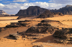 Wadi Rum I (zerega) Tags: travel sky cloud mountain color film archaeology rock clouds analog landscape geotagged sand nikon sandstone scenery asia mood view desert wadirum ad grain middleeast dramatic peak slide lookout jordan worldwari arab journey valley arabia vista nomad f2 sanddune archeology lawrenceofarabia highlight vistapoint jordanien majesty overview bedouin allure jordania jebel bedu archeologicalsite mediooriente nabataean telawrence scenicviewpoint interestingness53 nationalreserve jordani i500 kingdomofjordan archeologic desertpatrolcorps huweitat aramaua jebelummulaydiyya jeeptracks