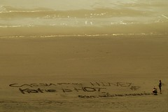 Message from Raglan (Catching Magic) Tags: newzealand beach writing graffiti sand olympus waikato e300 tiraudan raglan om43rds om4070r52mm