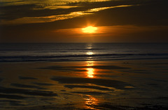 Puesta en Mazagn (pericoterrades) Tags: ocean sunset sea sun beach atardecer mar seaside sand bravo huelva playa 2006 atlantic cielo puestadesol bajamar atlntico orilla ocano mazagn pericoterrades abigfave