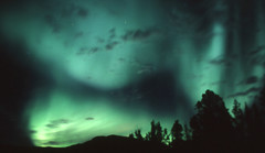 Spirits (storm light) Tags: sky canada green stars glow bc fluorescent midnight planet curtains rays luminous arcs atmospheric constellation northernlights auroraborealis phenomenon toadriver abigfave dancingcurtains faceintheaurora