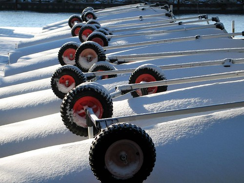 Snowy wheels on boats