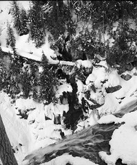 A snowy waterfall, somewhere in America... (Jonathan Harel) Tags: california blackandwhite bw usa snow 120 mamiya water mediumformat landscape waterfall noiretblanc kodak tmax westcoast rb67 exactlocationunknown aspiredtobeanansaladamsshot