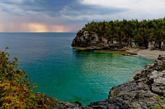 From the Shores of a Dream (Nathan Bergeron Photography) Tags: ontario canada storm beach water colors sunrise interestingness shoreline cliffs nationalparks brucepeninsula tobermory explored thebrucetrail specnature indianheadcove 25faves