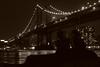 Lovers Beneath the Manhattan Bridge (Andrei Lintu) Tags: nyc newyorkcity sea bw usa newyork sepia 510fav nightshot lovers manhattanbridge canonef50mmf18ii andreilintu