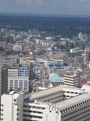 Nairobi downtown traffic (tik_tok) Tags: africa city travel digital canon landscape geotagged traffic kenya african centre nairobi capital a520 powershot roofs international conference jam height canonpowershot kenyatta eastafrica kicc