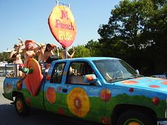 The M Peach Bush peach Truck (a3rynsun) Tags: art car truck austin bush peach 2006 parade m congress avenue