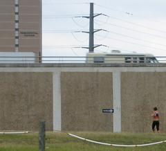 IMG_20061128_0154 (joshhikes) Tags: woman tower sign freeway oneway jogger jogbra residentil joshhimages