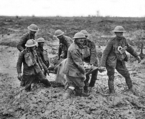PASSCHENDAELE: Stretcher bearers struggling through the mud near Boesinghe, Belgium. August 1, 1917