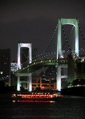 The rainbow bridge at night (manganite) Tags: bridge topf25 water colors japan architecture night strand digital geotagged lights tokyo boat interestingness nikon colorful asia ship nightshot tl playa explore  nippon  odaiba d200 nikkor dslr minato nihon kanto tokyobay rainbowbridge avl interestingness76 i500 18200mmf3556 tokyobeach utatafeature manganite nikonstunninggallery 25faves geo:lat=3563019480464062 geo:lon=1397751362732113 date:year=2006 date:month=september date:day=11
