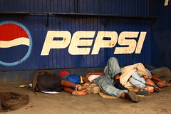 SleepingUnderPepsiSign.JPG - by pushplayproductions