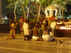 Praying for Romance at the Trimurti Shrine at Central World Plaza (dayvit78) Tags: flowers love night thailand ganesha shrine asia southeastasia bangkok prayer pray romance thai midnight offering valentines southeast bkk offerings trimurti centralworldplaza