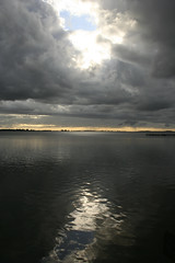 Una puerta al cielo ( SandroG) Tags: door sunset sky storm window argentina canon atardecer rebel xt tristeza puerta buenos aires lagoon cielo soledad laguna reflexion palmera chascomus