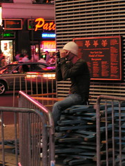 a real effort to take a photo in Times Square (incendiarymind) Tags: nyc newyorkcity neon photographer candid timessquare perch midtownmanhattan 222v2f totalstanger