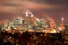 Calgary Glow (Picture Pages by Patrick) Tags: light sky canada cold color calgary colors skyline night clouds landscape cityscape alberta burst calgarytower interestingness48 i500 flickrchallengegroup flickrchallengewinner