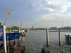 waiting for the water taxi, staring at temple off in the distance. (permanently scatterbrained) Tags: city thailand temple shrine asia bangkok buddhist thai southeast bkk watertaxi chaophrayariver landofsmiles