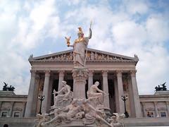 Pallas Athene (Mario's Planet) Tags: vienna wien blue sky white building fountain statue clouds greek austria golden cloudy columns statues parliament ring parlament pillars athena athene austrian pallas clouded ringstrae pallasathene