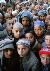 Afghanistan orphans (nick rain images) Tags: world life school portrait people afghanistan children soldier fight eyes war asia child muslim picture photojournalism location east orphans future landmines conflict survival kabul survivor global burqa ilo taleban