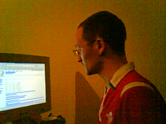 Owen at his pc (Mojen) Tags: cameraphone london boyfriend wales computer moblog phonecam pc britain rugby cymru wikipedia owen badlight rygbi rugbyshirt owenblacker sonyericssonw850i owenblackwe walesshirt