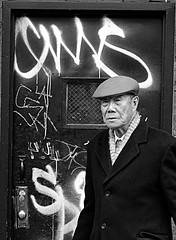 The Old man and the Graffiti door (noamgalai) Tags: china new nyc portrait people ny newyork face photography graffiti pig town photo chinatown year chinese picture chinesenewyear newyear photograph noam allrightsreserved   photomania  noamg galai noamgalai   pigyear wwwnoamgalaicom