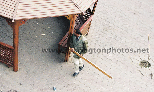 Mubarak's Gestapo agent, armed with a stick, hunting demonstrators