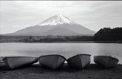 boat and Mt. Fuji (Screw Mount Leica IIIf + jupiter-8) (potopoto53age) Tags: bw mountain lake film monochrome japan outdoors boat kodak mtfuji jupiter8 trix400 blackwhitephotos screwmountleica shojilake