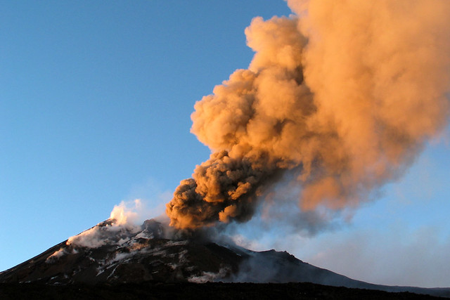 Etna ash eruption during sunset