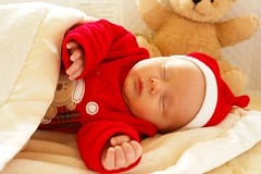 The newest love of my life---- (tollen) Tags: christmas pink red baby love golden perfect advent child grandson passion santasuit contented perfectlips 23rddecember sleepimg christmascalendar2006 perfecteverywhichway