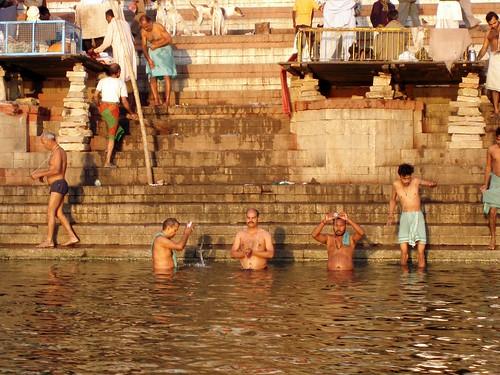 Washing, praying under the rising sun...