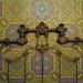 Brass headboard and wallpaper