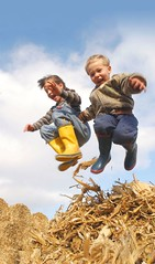 kids at Play (jmurphpix) Tags: boy sun girl youth happy jumping corn midwest warm flickr iowa hay agriculture 1735mmf28d carefree bail joemurphy josephlmurphy jmurphpix