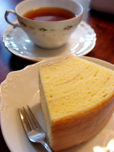 a piece of baumkuchen and a cup of tea