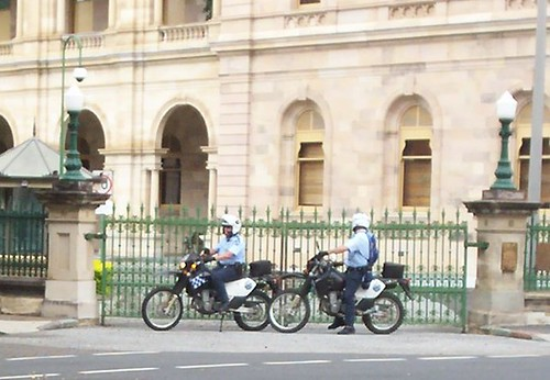 Police dirt bikes outside corner gate of Parliament House, Cnr George and Alice Sts - Invasion Day rally, Brisbane, Queensland, Australia-14