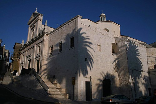 Church in Cisternino with palm trees
