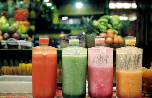 Four colorful smoothies lined up