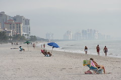 Naples, FL (jkc photos) Tags: camera people usa west building beach digital umbrella wow geotagged mexico rebel xt coast photo high amazing cool sand flickr gulf view unitedstates florida map or united north picture location tourists telephoto condo atlas naples resolution states cooler geotag 75300 sunbathing coordinates condominium e20ci