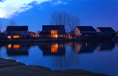 Tranquil (Jason Stair) Tags: blue trees houses sky orange color reflection oklahoma water delete10 clouds sunrise d50 delete9 delete5 dawn lights delete2 pond purple delete6 delete7 vivid delete8 delete delete4 save save2 golfcourse bold owasso cotcmostfavorited