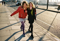 > (ponyintheair) Tags: uk girls shadow red england green london thames documentary contax t3 waterloobridge fujisuperia400 december06