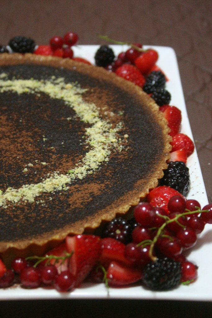 Bittersweet Chocolate Tart w/ Mixed Berries and pistachio praline